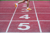 Runner crosses finish line — Stock Photo