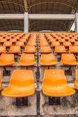 Front of the orange seats on the stadium — Stock Photo