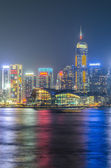 Hong Kong city skyline at night over Victoria Harbor — Stock Photo