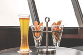 Beer, nuts in glass and snack — Stock Photo
