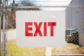 Exit sign on chain link fence — Foto de Stock
