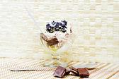 Ice cream with chocolate sauce — Stock Photo