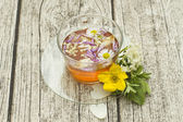 Cup of herbal tea with flowers — Stock Photo
