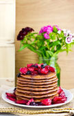 Pancakes with caramelized apples and blueberries, selective focus — Stock Photo