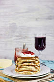Delicious pancakes with sour cream and homemade strawberry jam for breakfast, selective focus — Stock Photo