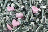 Heart in screws — Stock Photo