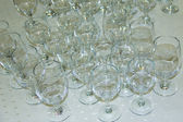 Many empty glasses in a line — Stock Photo