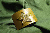Soviet soldier khaki buckle on green — Stock Photo