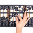 Woman's hands accounting with the abacus — Stock Photo #45415669