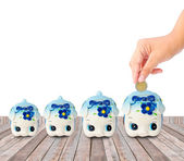 Money Saving with Piggy bank on wood background — Stock Photo