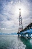 Sun shining oil rig — Stock Photo