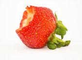 Half eaten strawberry — Stock Photo
