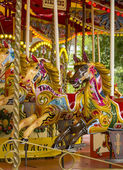 Vintage carousel or merry go round — Stock Photo