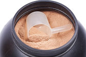 Scoop of chocolate whey isolate protein in a black plastic conta — ストック写真