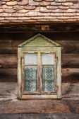 Windows of a wooden cottage — Stock Photo