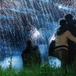 Big fireworks with young romantic couple in love in front, holdi — Stock Photo