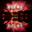 Huge fireworks with reflection on the water — Stock Photo #39861899
