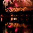 Huge fireworks with reflection on the water — Stock Photo #39861961