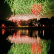 Huge fireworks with reflection on the water — Stock Photo