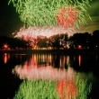 Huge fireworks with reflection on the water — Stock Photo #39862005