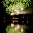 Huge fireworks with reflection on the water — Stock Photo #39862037