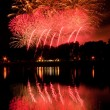 Stock Photo: Huge fireworks with reflection on the water