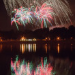 Huge fireworks with reflection on the water — Stock Photo #39862083