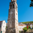 Stock Photo: BLATO, CROATI- AUGUST 9, 2010: Tower of parish Church of A