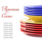 Stack of colorful ceramics plates in Romanian colors — Stockfoto