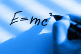 Hand writes the equation of the theory of relativity — Stock Photo