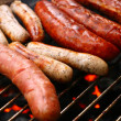Stock Photo: Sausages on grill
