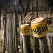 Two porcelain cups on a wooden fence — Stock Photo #42332763