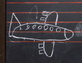 Childlike drawing of a plane — Stock Photo