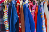 Colorful bathrobes displayed in a flea market — Stock Photo