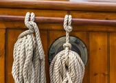 Ropes tied on the deck of an old wooden boat — Stock Photo
