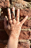 A hand with mhendi ornament — Stock Photo