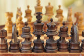A table with chess standing in two rows — Stock Photo