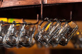 Hanging beer mugs — Stock Photo