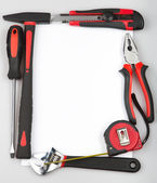 Tool set forming a frame on white background — Stock Photo