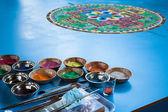 Creating a Buddhist sand mandala. — Stock Photo