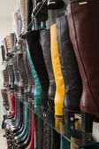 Rows of beautiful female boots on store shelves. — Stock Photo