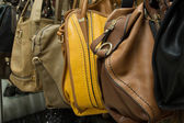 Rows of leather bags in store. — Stock Photo