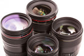 Several photographic lenses isolated on white background. — Stock Photo
