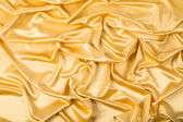 Abstract background, drapery gold fabric. — Stock Photo
