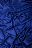 Abstract background, drapery blue fabric. — Stock Photo