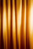 Abstract background, curtain, drapes gold fabric. — Stock Photo
