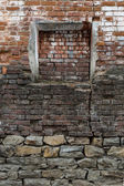 Immured window onto an old brick wall. Abstract background. — Stock Photo
