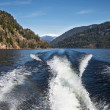 Trace motor boats on the water of a mountain lake. — Stock Photo