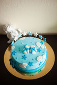 Blue birthday cake with stars — Stock Photo