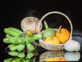 Pumpkins and banana — Stock Photo